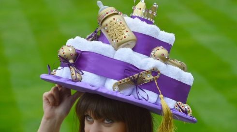 A woman wears a hat inspired by the forthcoming royal baby. Photograph: Reuters/Toby Melville