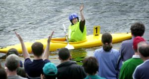 Nicola Higgins waves to the crowd  before competing in the preliminary round of division 4 kayaking. Photograph: Alan Betson