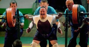 Robert Hill from the USA finds the strength in the squat lift competition at the  RDS