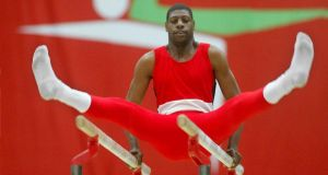 Trinidad's  Mascal Sheldon of Trinidad during his paralell bars routine at the RDS. Photograph: Inpho/morgan Treacy