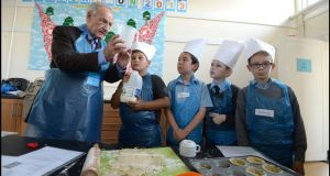 Denis Healy of the Ireland Fund gets  cooking with students at the King Boys' National School, Cabra. From left, Diego Paczkowski, Ryan Henderson Dylan Kenny and Richey Farrell. Photograph: Brenda Fitzsimons