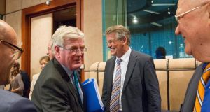 Tánaiste Eamon Gilmore greets MEPs Reimer Boge and Jean-Luc Dehaene, members of the European Parliament negotiating team.