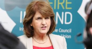 Minister for Social Protection Joan Burton is under growing pressure within the Government to do more to cut welfare spending. Photograph: Getty