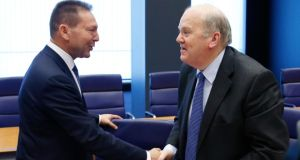 Minister for Finance  Michael Noonan greets Greece's finance minister Yannis Stournaras at the start of a euro zone finance ministers meeting in Luxembourg yesterday. Photograph: Francois Lenoir/Reuters