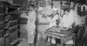Baking bread at the turn of the 20th century in New York. photograph: buyenlarge/getty images