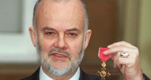 BBC Radio DJ John Peel with his OBE in 1998. He died in October 2004 at age 65.  Photograph: PA