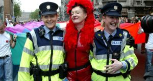 On parade: two members of the Garda get caught up in the 2005  Gay Pride march. Photograph: Fran Veale