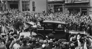 'No member of the government accompanied Hyde to St Patrick's Cathedral on the day of his inauguration. Government members attended a Votive Mass in the Pro-Cathedral instead. Presbyterian, Methodist and Jewish services were also held to mark the occasion.' Above, Douglas Hyde (in back of car holding top hat), leaving Dublin Castle with a cavalry escort following his inauguration as president on June 25th, 1938. Photograph: National Library of Ireland