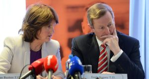 The Taoiseach, Enda Kenny, and the Minister for Social Protection, Joan Burton, at the launch of an independent evaluation of JobBridge , the national internship scheme, last month. Photograph: Eric Luke