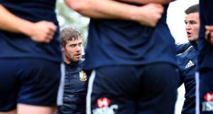 Lions Test fullback Leigh Halfpenny appears to listen intently as outhalf Jonny Sexton speaks during the captain's run out at  Churchie School in Brisbane. Photograph: Dan Sheridan/Inpho