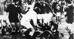 Willie Duggan scoring the Lions' only try in a match they lost to the New Zealand All Blacks 19-7 at Dunedin, New Zealand, in August 1977. The cheering Lions are (left to right), Peter Wheeler, Fran Cotton and Derek Quinnell.