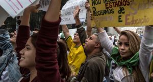 Protesters hold banners during a demonstration in São Paulo yesterday. Photograph: Mauricio Lima/The New York Times