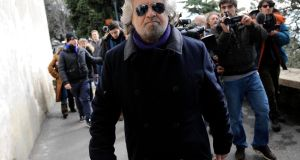 Beppe Grillo leaves after casting his vote at the polling station in Genoa in February this year. He has been accused of having an autocratic style of leadership. Photograph: Reuters