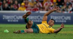 Kurtley Beale slips as he misses a late penalty against the British and Irish Lions. Photograph: David Gray/Reuters