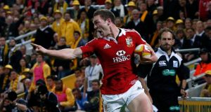 George North gestures as he goes clear to score the first try for the Lions. Photograph: David Gray/Reuters