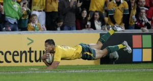 Israel Folau scores a try in the first half.