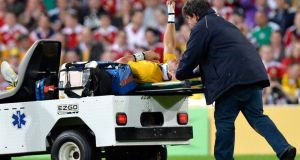Australia centre Christian Leali'ifano gives the thumbs up to the crowd as he is stretchered off the pitch following an injury sustained in the opening minute of the first Test  against the Lions in Brisbane. Photograph:   Bradley Kanaris/Getty Images
