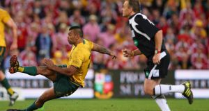 Referee Chris Pollock watches as Australia's Kurtley Beale  slips and misses a penalty in the last minute of the first Test against the British & Irish Lions in Brisbane. Photograph:  Cameron Spencer/Getty Images