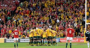 The Wallabies embrace shortly before kick-off. Photograph: Bradley Kanaris/Getty Images