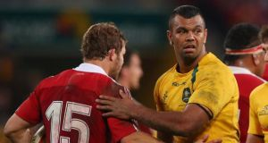 Kurtley Beale and Leigh Halfpenny shake hands after the match. Photograph: Chris Hyde/Getty Images