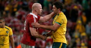 Paul O'Connell shakes hands with Rob Simmons after the match. David Gray/Reuters