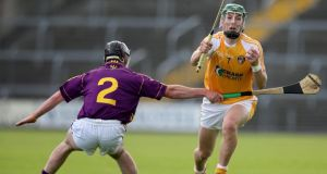 Wexford's Eoin Moore challenges  Paul Shiels of Antrim this afternoon. Photograph: Lorraine O'Sullivan/Inpho
