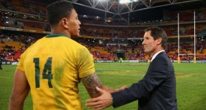 Robbie Deans, coach of the Wallabies shakes hands with Israel Folau  after losing the First Test against the British & Irish Lions at Suncorp Stadium  in Brisbane, Australia. Photograph: Cameron Spencer/Getty Images
