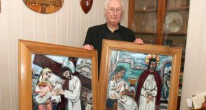 Fr Martin McNamara with two of Evie Hone's paintings of the  stations of the cross in Ss Peter and Paul church in Kiltullagh, Co Galway. Photograph: Hany Marzouk