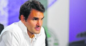 Roger Federer  talks to the media during previews for Wimbledon. Photograph: Jon Buckle