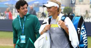 Rory McIlroy and his girlfriend Caroline Wozniacki, who rejects the suggestion that their relationship is affecting their respective sporting careers.