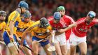 Clare's Cian Dillon and Patrick Horgan tussle for possession with Cian McCarthy of Cork. Photograph: Cathal Noonan/Inpho