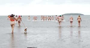 "Women take part in the ""Dip In The Nip"" fundraiser in aid of the Mercy University Hospital Foundation and cancer services at Pillmore beach in Youghal, Co Cork, yesterday. It was one of several similar events held over the weekend. Photograph: Diane Cusack"