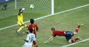 Spain's Fernando Torres, right, scores his side's second.