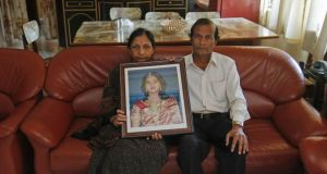 Mahadevi and Andanappa Yalagi, parents of Savita Halappanavar, hold her portrait as their house in Belgaum in the southern Indian state of Karnataka. Photograph: Danish Siddiqui/Reuters