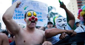 Demonstrators participate in an anti-government protest in Sao Jose dos Campos. Massive protests in Brazil haved tapped into widespread anger at poor public services, police violence and government corruption. Photograph: Roosevelt Cassio/Reuters