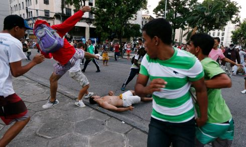 Demonstrators fight during a protest against the Confederations Cup and President Dilma Rousseff's government in Recife City June 20, 2013. The demonstrators were fighting after a group tried to stop several fellow protesters from vandalising property and throwing rocks at policemen.  Photograph: Marcos Brindicci/Reuters