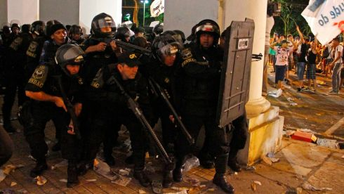 Police take up position against demonstrators in Belem.The protests come one month before Pope Francis is scheduled to visit Brazil, and ahead of the 2014 World Cup and 2016 Olympics, raising concerns about how Brazilian officials will provide security.  Photograph: Ney Macondes/Reuters