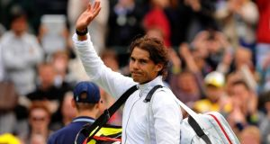 Spain's Rafael Nadal waves to the crowd after losing to Belgium's Steve Darcis during day one of the Wimbledon Championships . Photograph: Dominic Lipinski/PA Wire