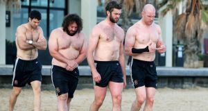 Paul O'Connell, far right, with, left to right, Mike Phillips, Adam Jones and O'Connell's second Test replacement Geoff Parling on St Kilda's Beach, Melbourne. Photograph: Dan Sheridan/Inpho