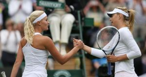 Maria Sharapova of Russia shakes hands at the net with Kristina Mladenovic of France after their  first round match on day one of Wimbledon.  Photograph: Clive Brunskill/Getty Images