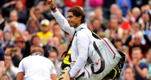 Spain's Rafael Nadal waves to the crowd after losing to Belgium's Steve Darcis on day one of the Wimbledon Championships. Photograph: Dominic Lipinski/PA