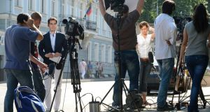 Television journalists give reports outside the Ecuador embassy in Moscow yesterday. Photograph: James Hill/The New York Times