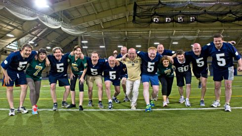 Connor Murphy, Jane ni Dhulchaointigh, Dan Kiely, Caroline Keeling, Michael McCartney, Ian Venner, Cahil O'Connell, Kevin Whelan, Kieran Fitzpatrick, Shane Leahy, Eleanor McEvoy, Pat O'Flynn, Ciaran Mulligan and Matthew Brown at Notre Dame's indoor training facility. Go Irish!