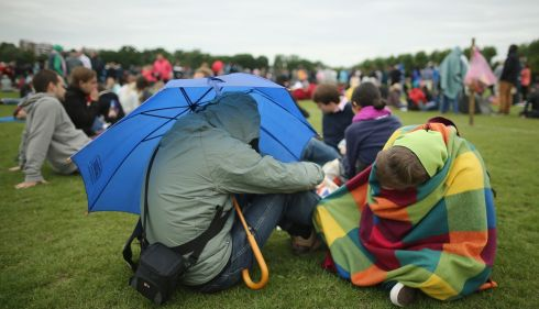 Fans try to sleep while queuing for entry into Wimbledon grounds. Photograph: Dan Kitwood/Getty Images