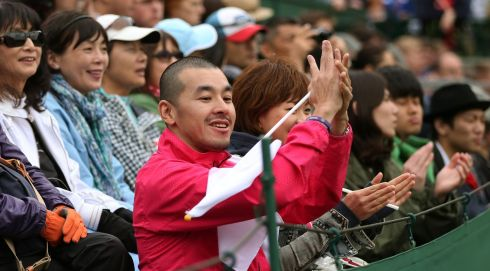 Fans cheer Misaki Doi of Japan during her Women's Singles match against Silvia Soler Espinosa of Spain. Photograph: Clive Brunskill/Getty Images