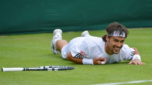 Fabio Fognini of Italy smiles after slipping in his men's singles tennis match against Jurgen Melzer of Austria. Photograph: Toby Melville/Reuters