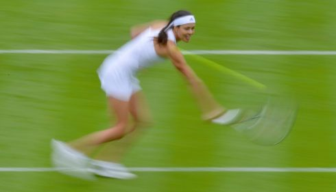 It's all just a blur: Ana Ivanovic of Serbia hits a return to Virginie Razzano of France. Photograph: Toby Melville/Reuters