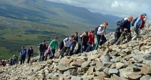 Open-air ritual: pilgrims climb Croagh Patrick on Garland Sunday. Photograph: Eric Luke/The Irish Times