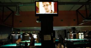 A TV screen in a St Petersburg pool hall shows former US spy agency contractor Edward Snowden during a news bulletin. Photograph: Alexander Demianchuk/The Irish Times