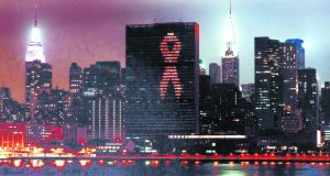 The United Nations building in New York lit with the red Aids ribbon in 2001 to highlight the general assembly special session on HIV/Aids. Photograph: Eskinder Debebe/Reuters